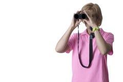 Mulher que olha através dos binóculos Imagens de Stock