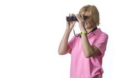 Mulher que olha em binóculos Imagens de Stock