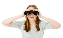 Mulher que olha em pares de vidros Imagem de Stock
