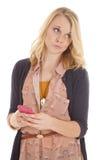 Mulher que olha lateral com texto do telefone imagens de stock