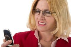 Mulher que olha o telemóvel Fotografia de Stock Royalty Free