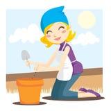 Mulher que planta sementes Imagens de Stock
