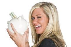Mulher que prende o banco Piggy Fotos de Stock Royalty Free