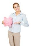 Mulher que prende o banco Piggy imagens de stock