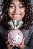 Mulher que prende o banco Piggy fotografia de stock