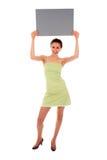 Mulher que prende o sinal em branco Imagens de Stock Royalty Free