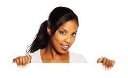 Mulher que prende um quadro indicador Imagem de Stock Royalty Free