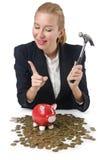 Mulher que quebra o banco piggy Imagem de Stock