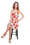 Mulher que senta-se na cadeira. Imagem de Stock Royalty Free