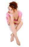 Mulher que senta-se no vestido cor-de-rosa Imagem de Stock Royalty Free