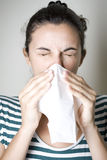 Mulher que Sneezing Imagem de Stock Royalty Free