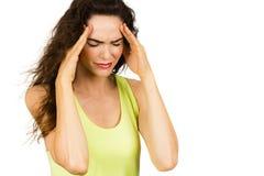 Mulher que sofre da dor de cabeça má imagem de stock