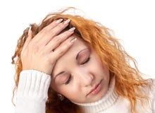 Mulher que sofre da dor de cabe Foto de Stock