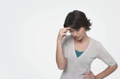 Mulher que sofre da dor de cabeça Fotografia de Stock