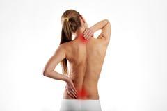 Mulher que sofre da dor lombar foto de stock