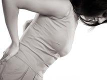 Mulher que sofre da dor nas costas da dor lombar Imagens de Stock