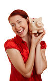 Mulher que sorri com banco piggy Fotografia de Stock Royalty Free