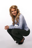 Mulher que squatting Foto de Stock