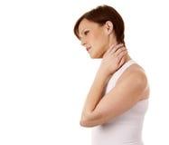 Mulher que tem uma dor de pescoço fotos de stock royalty free