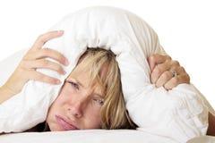 Mulher que tenta dormir Imagem de Stock Royalty Free