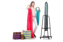 Mulher que tenta a roupa nova Fotografia de Stock Royalty Free
