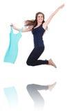 Mulher que tenta a roupa nova Fotografia de Stock