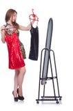 Mulher que tenta a roupa nova Imagens de Stock