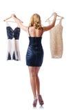 Mulher que tenta vestidos novos Imagem de Stock