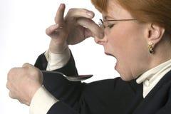 Mulher que toma a medicina desagradável Fotos de Stock Royalty Free