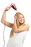 Mulher que usa o hairdryer Foto de Stock Royalty Free