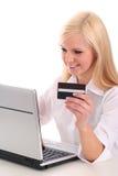 Mulher que usa o portátil Imagem de Stock Royalty Free