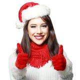 Mulher que veste os polegares de Santa acima Foto de Stock Royalty Free