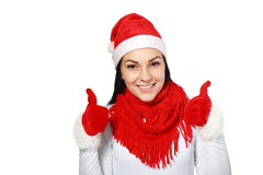 Mulher que veste os polegares de Santa acima Fotos de Stock