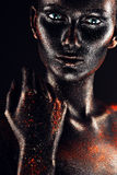 Mulher quente surreal na pintura preta Fotos de Stock