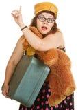 Mulher retro que graniza um táxi Fotografia de Stock