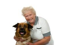 Mulher sênior com seu cão imagens de stock