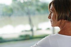 Mulher sênior pensativa Imagem de Stock Royalty Free