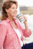 Mulher sênior que relaxa ao ar livre Fotografia de Stock Royalty Free