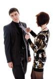 A mulher scissor o laço, homem novo. Imagem de Stock Royalty Free