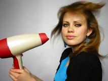 A mulher seca o cabelo o secador de cabelo Fotos de Stock
