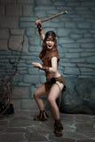 Mulher selvagem com um machado Imagem de Stock Royalty Free