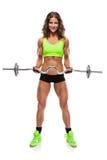 Mulher 'sexy' agradável que faz o exercício com o peso grande (retocado) Imagem de Stock