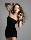 Mulher 'sexy' bonita do encanto Fotografia de Stock Royalty Free