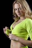 Mulher 'sexy' bonita nova que unbuttoning uma parte superior verde Fotos de Stock Royalty Free