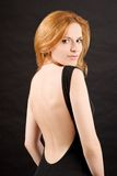 Mulher 'sexy' do redhead no vestido preto Foto de Stock Royalty Free