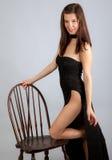 Mulher 'sexy' no vestido preto longo Foto de Stock