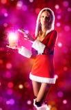 Mulher 'sexy' nova na roupa de Santa Imagens de Stock