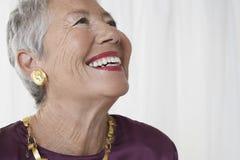 Mulher superior alegre que olha acima Fotografia de Stock Royalty Free