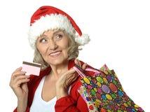 Mulher superior com sacos de compras Imagem de Stock