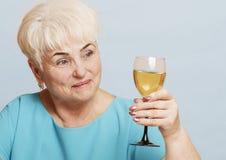 Mulher superior com vidro do vinho branco Imagem de Stock Royalty Free